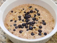Pour in baking dish and top with blueberries and crushed walnuts